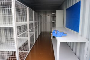 Shipping container workshop cage shelving