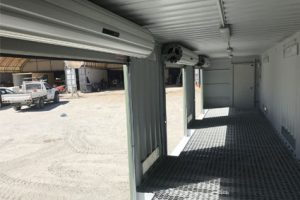 Shipping container workshop roller doors